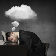 businessman sleeping and dreaming with cloud